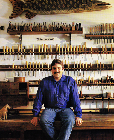Stephen Huneck in his woodcarving workshop and studio