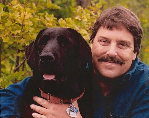 Stephen Huneck with Sally the black lab